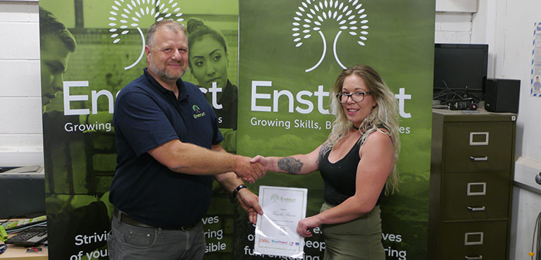 GREAT Participant receives her certificate