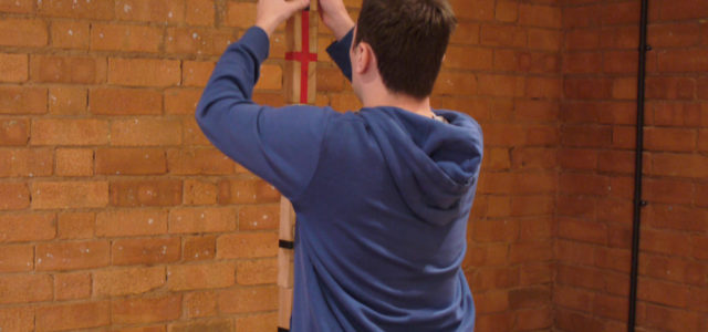 Participant is stacking blocks as part of a GREAT team building activity